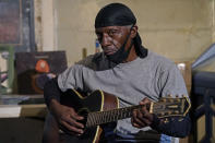 "Bluesman Jimmy ""Duck"" Holmes plays a quick ditty at the Blue Front Cafe in Bentonia, Miss., Jan. 21, 2021. Holmes' ninth album, ""Cypress Grove,"" has earned a Grammy nomination for the Best Traditional Blues Album. (AP Photo/Rogelio V. Solis)"