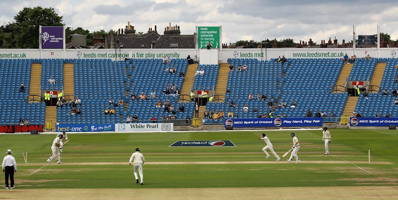 LEEDS, ENGLAND - JULY 21:  Mitchell Johnson of Australia is bowled by Mohammad Aamer of Pakistan in front of a sparse crowd on the Western Terrace during day one of the 2nd Test between Pakistan and Australia played at Headingley Carnegie Stadium on July 21, 2010 in Leeds, England.  (Photo by Hamish Blair/Getty Images)