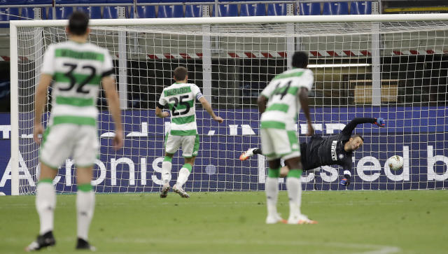 Sassuolo's Domenico Berardi, second from left, scores on a penalty kick his side's second goal during the Serie A soccer match between Inter Milan and Sassuolo at the San Siro Stadium, in Milan, Italy, Wednesday, June 24, 2020. (AP Photo/Luca Bruno)