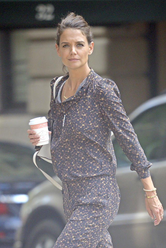 <p>Holmes was without her usual accessory, daughter Suri Cruise, during a recent walk down New York City's Madison Avenue. However, she did have a classic Big Apple accessory: a cup of joe. (Photo: Splash News) </p>