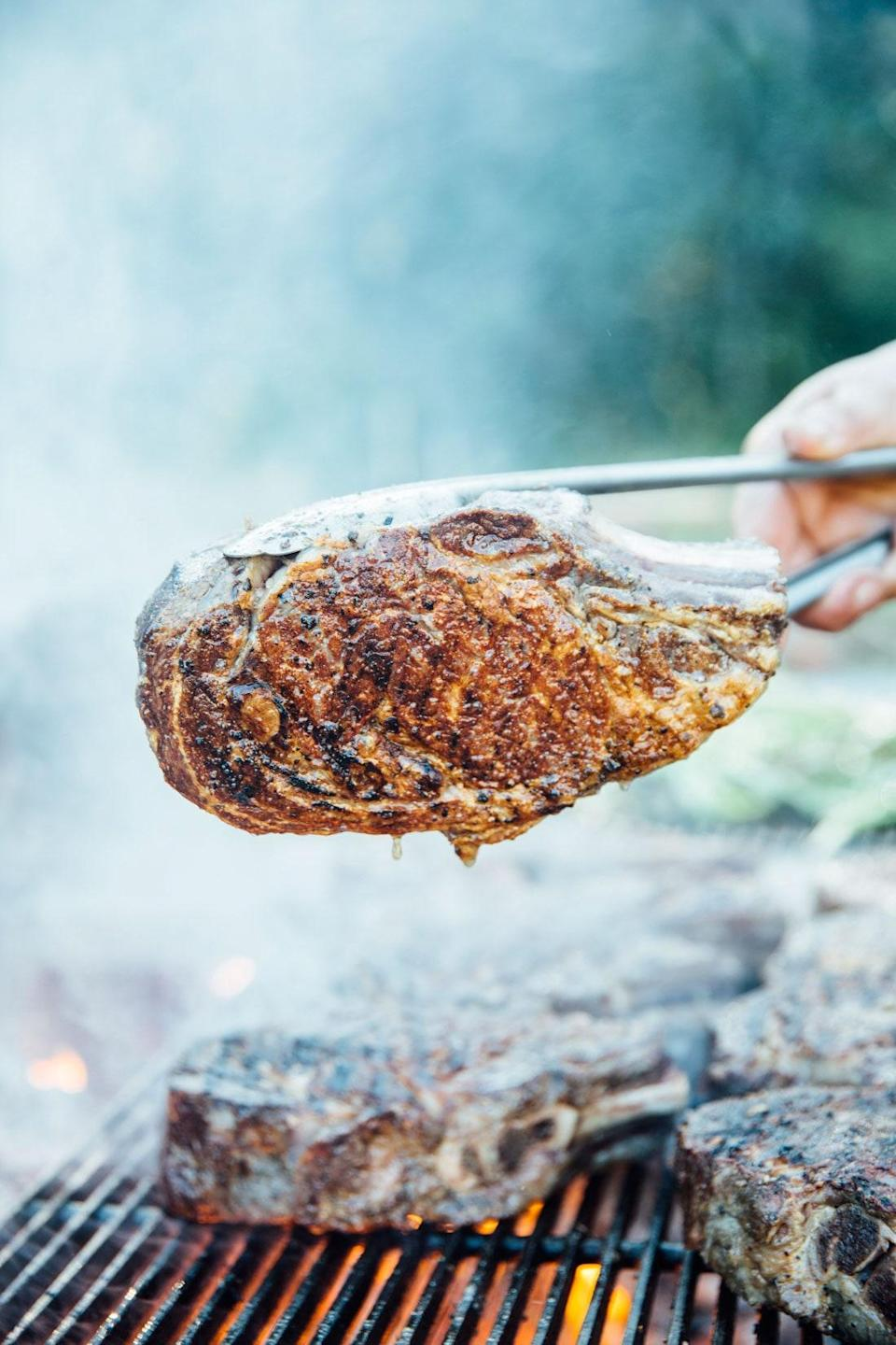 """Let it rain with the kosher salt—for the best flavor, you want to season these simple steaks really well before they get grilled. Great with <a href=""""http://www.bonappetit.com/recipe/garlicky-harissa?mbid=synd_yahoo_rss"""" rel=""""nofollow noopener"""" target=""""_blank"""" data-ylk=""""slk:Garlicky Harissa"""" class=""""link rapid-noclick-resp"""">Garlicky Harissa</a> or <a href=""""http://www.bonappetit.com/recipe/charred-tomatillo-chermoula?mbid=synd_yahoo_rss"""" rel=""""nofollow noopener"""" target=""""_blank"""" data-ylk=""""slk:Charred Tomatillo Chermoula"""" class=""""link rapid-noclick-resp"""">Charred Tomatillo Chermoula</a>. <a href=""""https://www.bonappetit.com/recipe/grilled-bone-in-rib-eye?mbid=synd_yahoo_rss"""" rel=""""nofollow noopener"""" target=""""_blank"""" data-ylk=""""slk:See recipe."""" class=""""link rapid-noclick-resp"""">See recipe.</a>"""