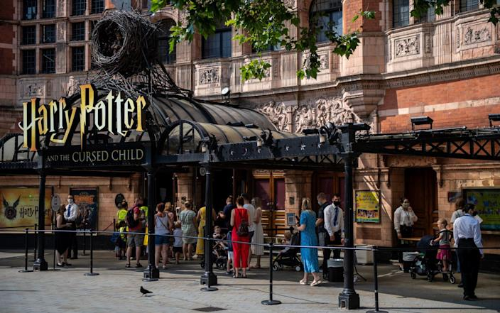"""Theatre goers queue for a performance of Harry Potter and the Cursed Child at Palace Theatre on July 21, 2021 in London, England. Several UK theatre productions have either closed or been unable to premiere due to cast members having to isolate after being """"pinged"""" by the NHS test and trace app. Composer Andrew Lloyd Webber has postponed the opening of Cinderella in the West End saying that the government's isolation policy is a """"blunt instrument"""" after there was a covid case amongst the cast. - Getty Images"""