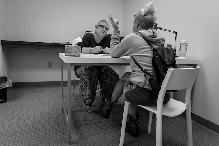 <p>Cynthia Abney listens to a recovering heroin addict at Groups in Middletown, Ohio.<br> (Photograph by Mary F. Calvert for Yahoo News) </p>