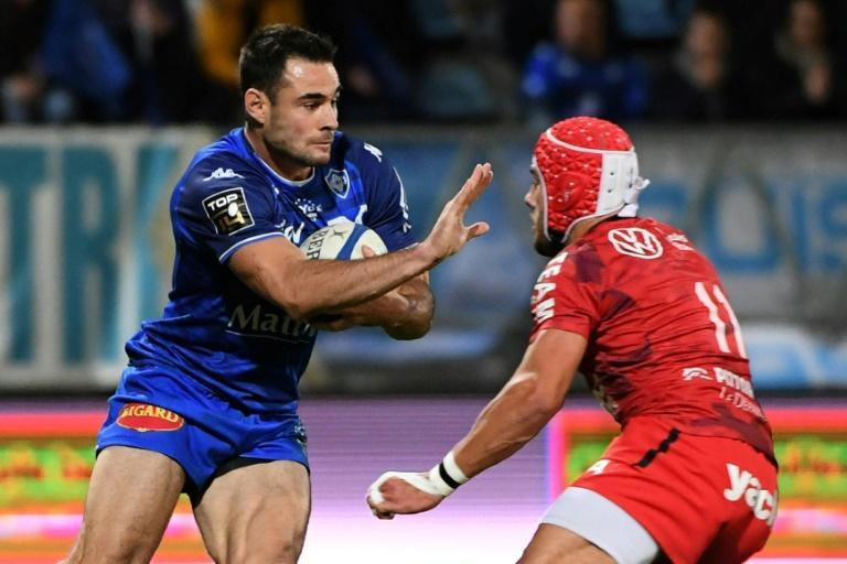 Pushed around: Castres full back Geoffrey Palis prepares to hand off wing Gabin Villiere as Toulon lost agaon last week (AFP/Fred SCHEIBER)
