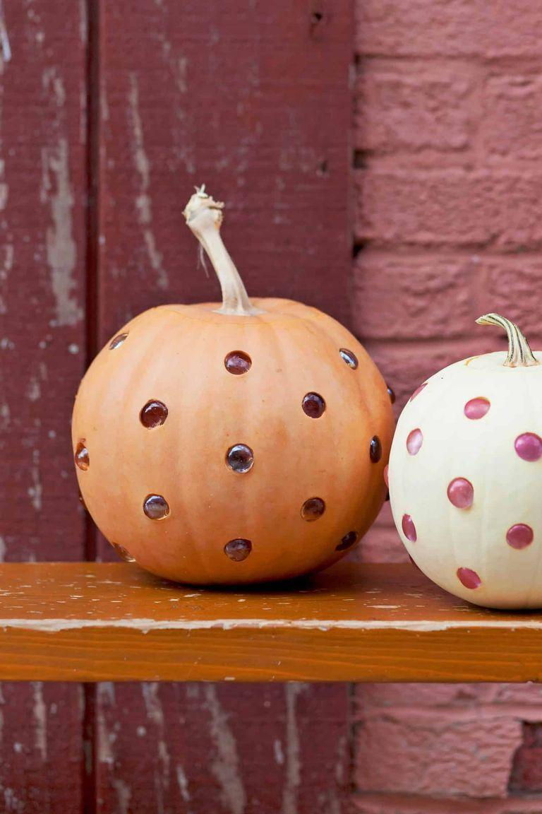 """<p>For a more artistic pumpkin, pop glass marbles into carved holes. Place a candle inside to give them a glowing effect.</p><p><strong>Get the tutorial at <a href=""""https://abeautifulmess.com/2017/10/glass-bead-jack-o-lanterns.html"""" rel=""""nofollow noopener"""" target=""""_blank"""" data-ylk=""""slk:A Beautiful Mess"""" class=""""link rapid-noclick-resp"""">A Beautiful Mess</a>.</strong></p><p><strong><a class=""""link rapid-noclick-resp"""" href=""""https://go.redirectingat.com?id=74968X1596630&url=https%3A%2F%2Fwww.walmart.com%2Fsearch%2F%3Fquery%3Dmarbles&sref=https%3A%2F%2Fwww.thepioneerwoman.com%2Fhome-lifestyle%2Fcrafts-diy%2Fg36982763%2Fpumpkin-carving-ideas%2F"""" rel=""""nofollow noopener"""" target=""""_blank"""" data-ylk=""""slk:SHOP MARBLES"""">SHOP MARBLES</a><br></strong></p>"""