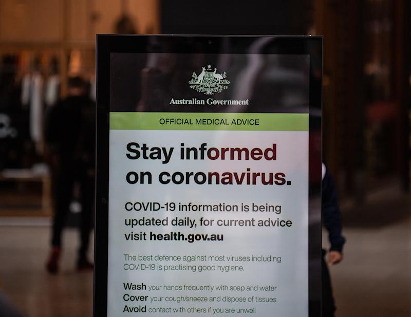 An advertising board showing a government notice about coronavirus in Sydney, Monday, March 16, 2020. Source: AAP Image.