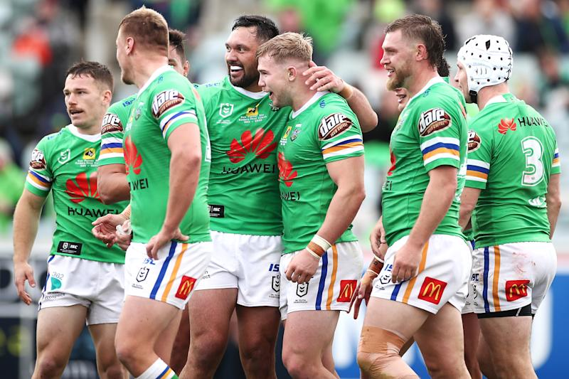 Hudson Young of the Raiders celebrates with his team mates after scoring a try during the round 19 NRL match between the Canberra Raiders and the New Zealand Warriors.