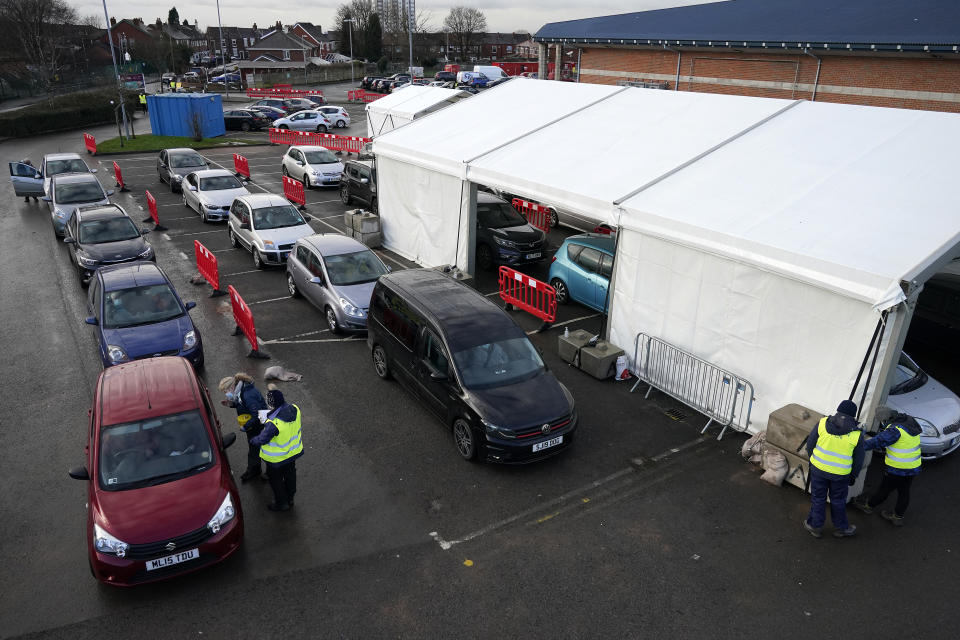 HYDE, ENGLAND - JANUARY 08: People sit in their cars as they are administered the Pfizer/BioNTech coronavirus vaccine at a drive-thru COVID-19 vaccination centre at Hyde Leisure Centre on January 08, 2021 in Hyde, England. The coronavirus drive-through vaccine centre is believed to be the first in the world. (Photo by Christopher Furlong/Getty Images)