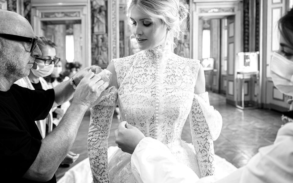 Domenico Dolce puts the finishing touches to Lady Kitty's wedding dress - Dolce and Gabbana