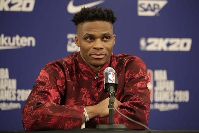 Wearing a Chinese-style shirt, Houston Rockets' Russell Westbrook attends a news conference after the team's NBA preseason basketball game against the Toronto Raptors Tuesday, Oct. 8, 2019, in Saitama, near Tokyo. (AP Photo/Jae C. Hong)