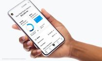 Stash's stock trading app is seen on a phone