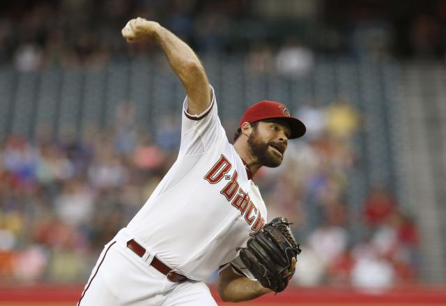 Arizona Diamondbacks' Josh Collmenter throws a pitch against the Philadelphia Phillies during the first inning of a baseball game on Friday, April 25, 2014, in Phoenix. (AP Photo/Ross D. Franklin)