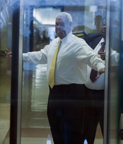 This photo taken through a courthouse window shows Washington businessman Jeffrey Thompson checked by security as he enters the federal courthouse in Washington, Monday, March 10, 2014. Thompson was charged Monday with conspiracy to violate federal and local campaign finance laws by funding off-the-books campaign activity for candidates including Hillary Rodham Clinton and district Mayor Vincent Gray. after being charged this morning in a criminal information with two conspiracy offenses stemming from an ongoing investigation . Thompson is suspected of funneling illicit funds into Mayor Gray's campaign.(AP Photo/Cliff Owen)