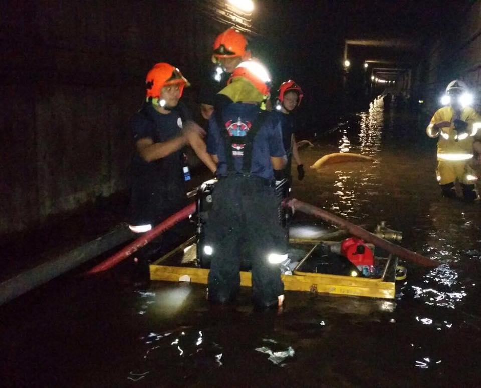 SCDF personnel clearing the flooded MRT tunnel. (PHOTO: SCDF)