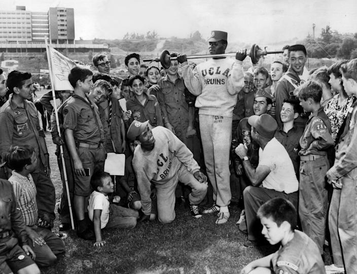 July 23, 1960: Rafer Johnson demonstrates physical fitness to some 900 Boy Scouts taking part in a two-day Camporee at UCLA.