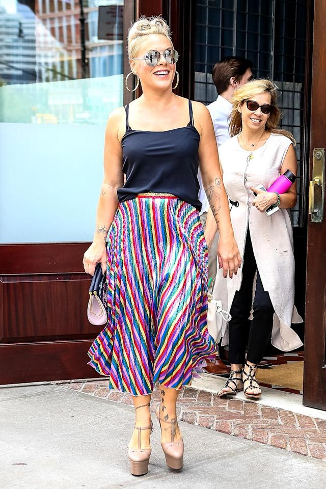<p>Leave it to Pink to strut around the streets of New York City flawlessly in those heels. The singer looked happy — and colorful — while attending a meeting at Sony Headquarters in Manhattan. (Photo: Backgrid)<br><br></p>