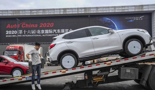 Cars are delivered for the upcoming Auto China 2020 show in Beijing, which starts on Saturday. Photo: AP Photo