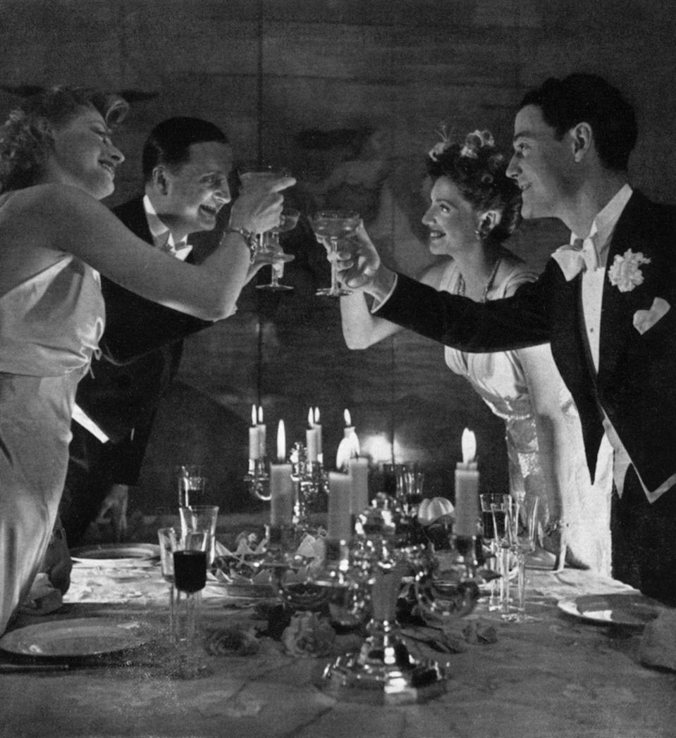 "<p>Toasts were a standout part of any mid-century party. It wasn't limited to just the host, so it wasn't uncommon for more than one person to raise a glass throughout the night with <a href=""https://www.huffpost.com/entry/1960-cocktail-party_n_6793908"" data-ylk=""slk:either a funny limerick"" class=""link rapid-noclick-resp"">either a funny limerick</a> or a sincere thanks.</p>"