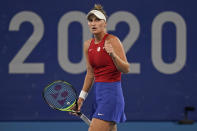 Marketa Vondrousova, of the Czech Republic, reacts after winning a point off Naomi Osaka, of Japan, during the third round of the tennis competition at the 2020 Summer Olympics, Tuesday, July 27, 2021, in Tokyo, Japan. (AP Photo/Seth Wenig)