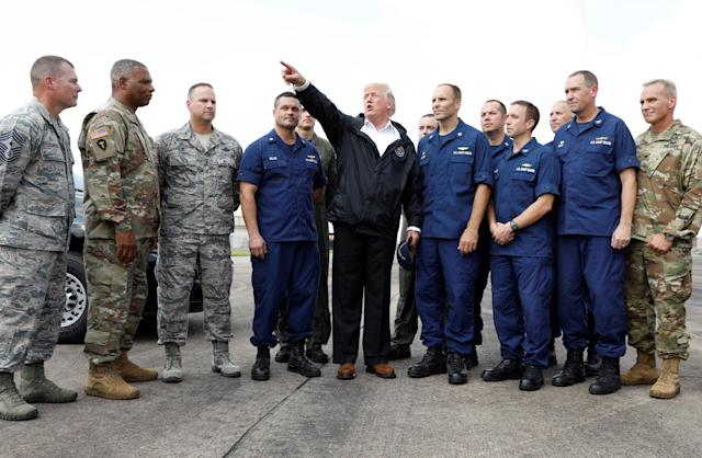 <p>President Donald Trump speaks with troops and members of the United States Coast Guard at Ellington Field after meeting with flood survivors and volunteers who assisted in relief efforts in the aftermath of Hurricane Harvey, in Houston, Texas, Sept. 2, 2017. (Photo: Kevin Lamarque/Reuters) </p>
