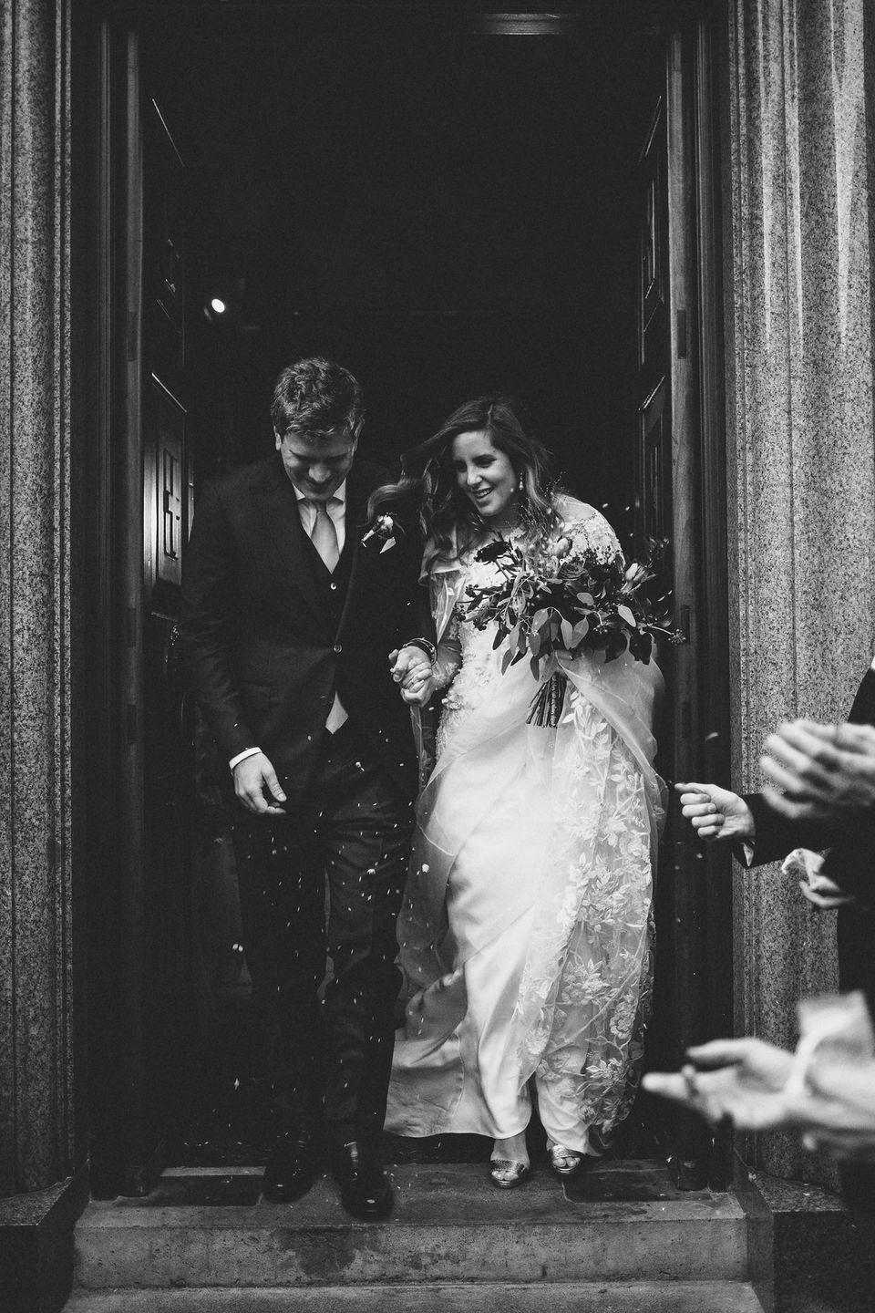 <p><strong>Wedding dress and cape:</strong> Bespoke design by Emma Victoria Payne</p><p><strong>Shoes:</strong> Jimmy Choo</p><p><strong>Earrings:</strong> Vintage (from her grandmother)</p>