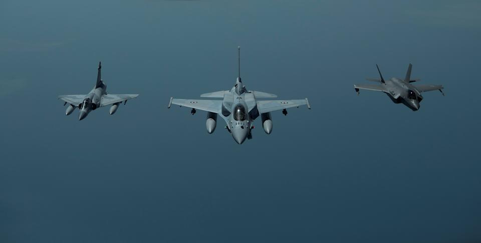 FILE PHOTO: A United Arab Emirates Air Force Mirage 2000 (L), UAE F-16 Desert Falcon (C) and a U.S. F-35A Lightning II (R) fly a partnering flight in the U.S. Central Command area of responsibility, in the Arabian Gulf, May 29, 2019. Picture taken May 29, 2019. Chris Drzazgowski/U.S. Navy/Handout via REUTERS