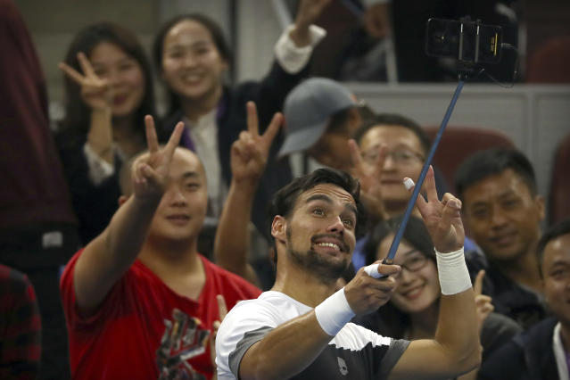 Fabio Fognini of Italy poses for a selfie with fans after beating Andrey Rublev of Russia in their second round men's singles match in the China Open at the National Tennis Stadium in Beijing, Thursday, Oct. 4, 2018. (AP Photo/Mark Schiefelbein)