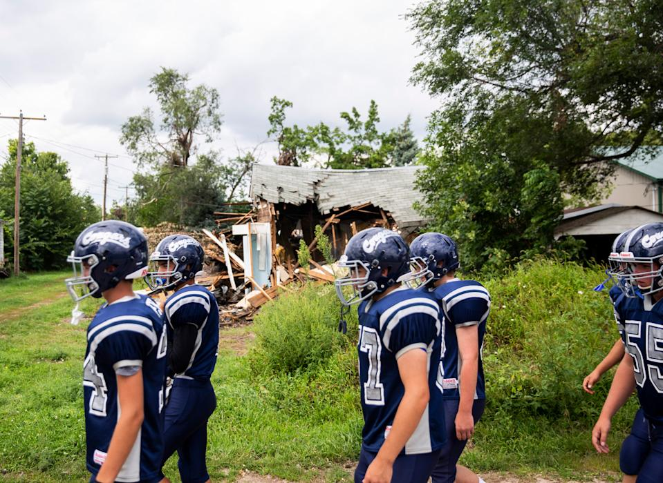 The Burke High School football team walks to Tolstedt Field on Friday in Burke, S.D.