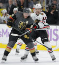 Vegas Golden Knights defenseman Nate Schmidt (88) vies for the puck with Chicago Blackhawks center Dylan Strome (17) during the first period of an NHL hockey game Wednesday, Nov. 13, 2019, in Las Vegas. (AP Photo/John Locher)