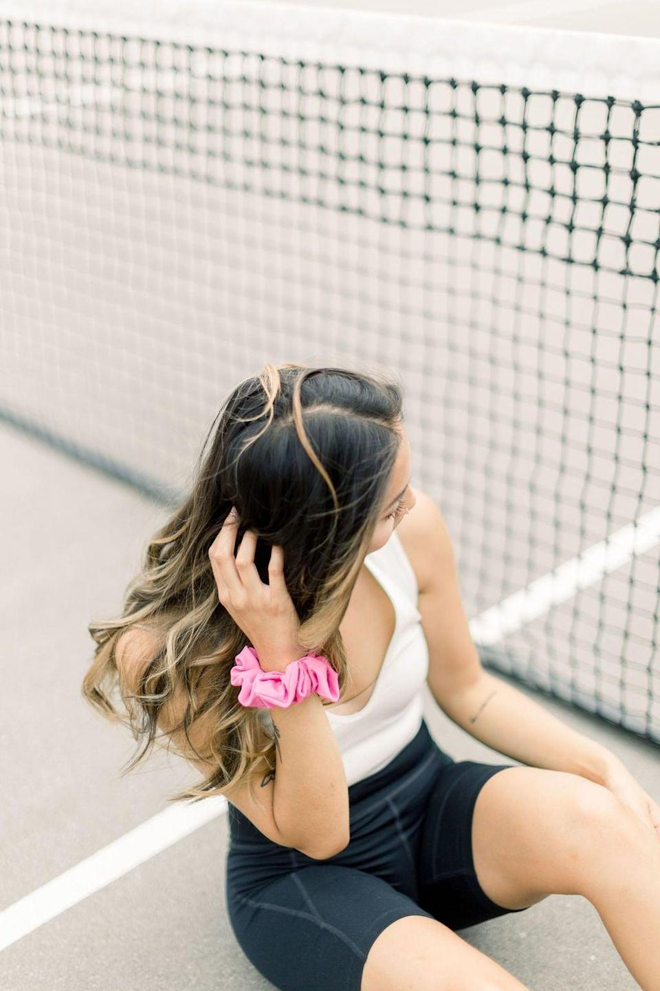 """<p>""""I'm not a big scrunchie girl, but I gave the <a href=""""https://www.popsugar.com/buy/Active-Swim-Scrunchie-578917?p_name=Active%20%2B%20Swim%20Scrunchie&retailer=chelseaking.shop&pid=578917&price=18&evar1=fit%3Auk&evar9=47513257&evar98=https%3A%2F%2Fwww.popsugar.com%2Ffitness%2Fphoto-gallery%2F47513257%2Fimage%2F47518335%2FActive-Swim-Scrunchie&list1=healthy%20living&prop13=api&pdata=1"""" class=""""link rapid-noclick-resp"""" rel=""""nofollow noopener"""" target=""""_blank"""" data-ylk=""""slk:Active + Swim Scrunchie"""">Active + Swim Scrunchie</a> ($18) from Chelsea + King and was pleasantly surprised. My hair gets heavy when it gets long (thanks, quarantine!) and regular hair ties aren't usually strong enough to hold it all up, which results in sagging ponytails that pull on my scalp. These scrunchies are secure enough to keep a bun in place during yoga and low-impact workouts, and they're moisture-wicking to keep sweat away. I'm loving the bright colors, too!"""" - MR</p>"""