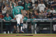 Seattle Mariners' J.P. Crawford crosses the plate to score on a single by Ty France against the Los Angeles Angels during the seventh inning of a baseball game Friday, July 9, 2021, in Seattle. (AP Photo/Ted S. Warren)