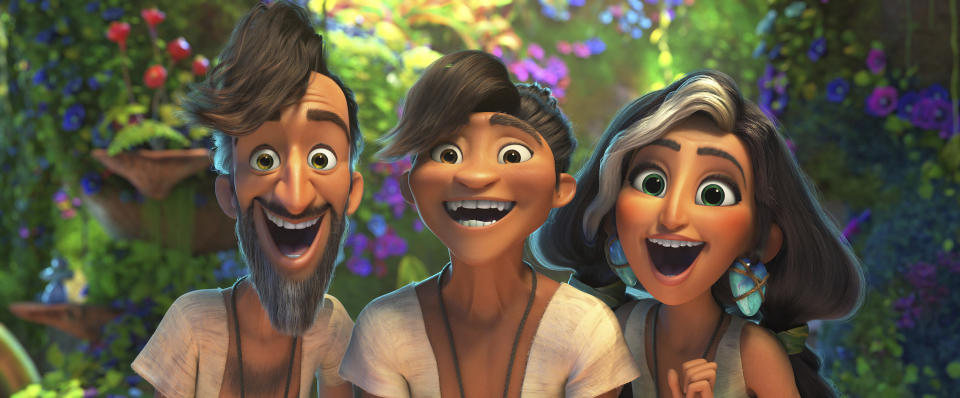 """In this image provided by DreamWorks Animation, Phil Betterman, from left, (Peter Dinklage), Guy (Ryan Reynolds) and Hope Betterman (Leslie Mann) in a scene from DreamWorks Animation's """"The Croods: A New Age,"""" directed by Joel Crawford. The movie was released at Thanksgiving 2020. (DreamWorks Animation LLC via AP)"""