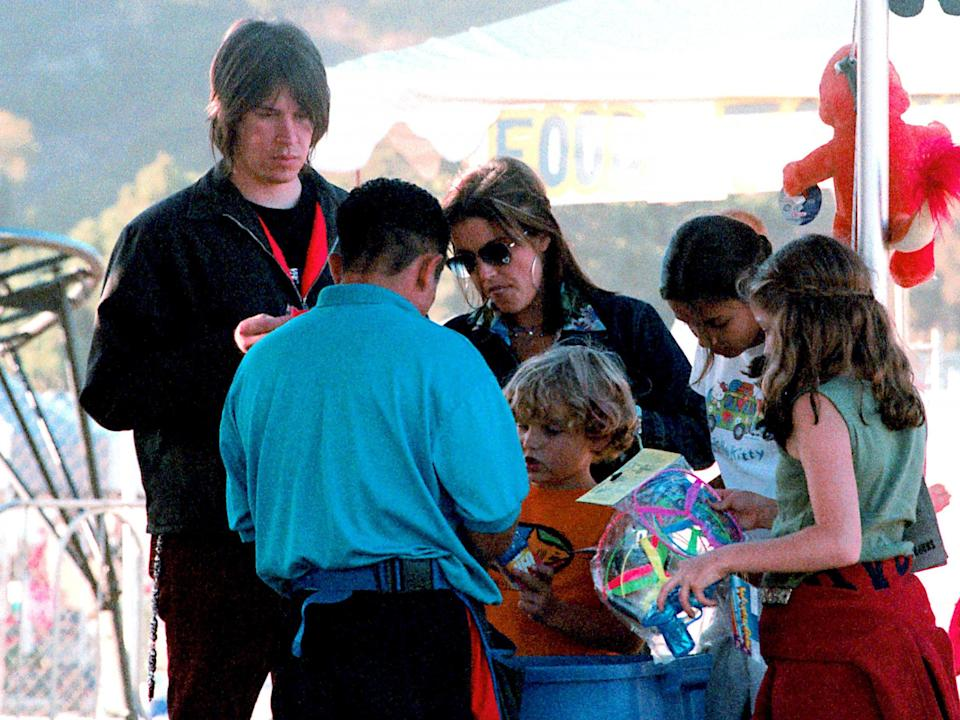 Benjamin Keough, centre, pictured as a child with his family in 2000: Getty Images