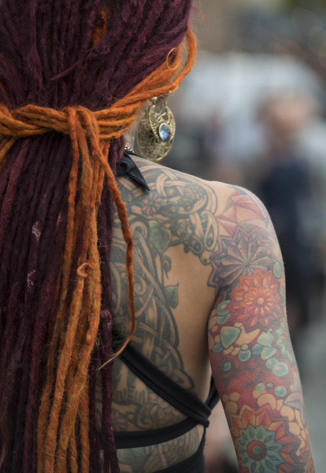 <p>A visitor with her tattooed arm and back at the London Tattoo convention at Tobacco Dock on Sept. 23, 2017 in London, England. (Photo: James D. Morgan/Getty Images) </p>