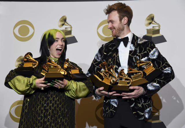 Billie Eilish, left, and Finneas O'Connell pose at the 62nd annual Grammy Awards. (AP Photo/Chris Pizzello)