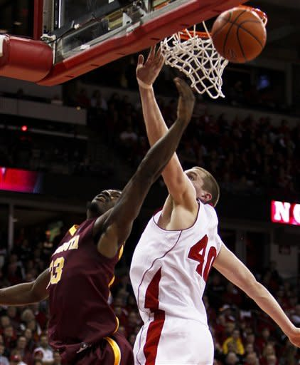Minnesota's Chip Armelin, left, shoots against Wisconsin's Jared Berggren during the first half of an NCAA college basketball game Tuesday, Feb. 28, 2012, in Madison, Wis. (AP Photo/Andy Manis)