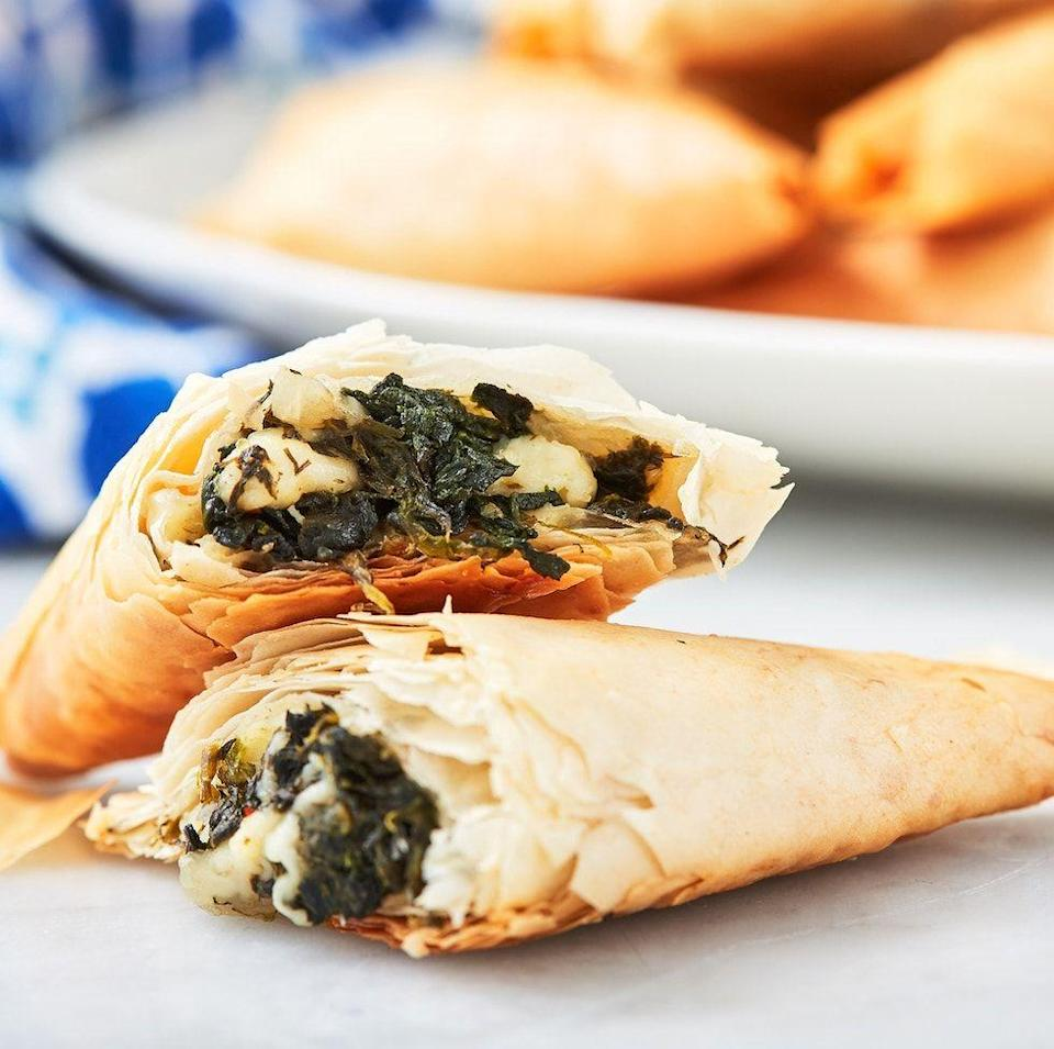 """<p>Don't forget to cover your filo dough with a lightly damp kitchen towel. Uncovered, the dough gets hard and dry in record time, and it is NOT pleasant trying to fold a crumbly sheet of filo. </p><p>Get the <a href=""""https://www.delish.com/uk/cooking/recipes/a31149387/spanakopita-spinach-pie-recipe/"""" rel=""""nofollow noopener"""" target=""""_blank"""" data-ylk=""""slk:Spanakopita"""" class=""""link rapid-noclick-resp"""">Spanakopita</a> recipe.</p>"""