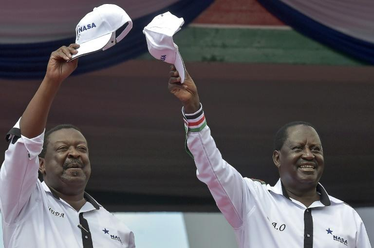Former prime minister Raila Odinga (right) and ex-deputy premier Wycliffe Musalia Mudavadi greet supporters during an opposition rally in Nairobi, on April 27, 2017