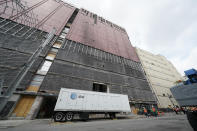 A trailer sits in front of a damaged AT&T office building Friday, June 25, 2021, in Nashville, Tenn. Six months after a Christmas Day bombing ripped a hole in historic downtown, workers continue to chip away at cleanup efforts so that revitalization can begin. The tediously slow process has meant workers haven't been able to access some of the buildings until recent weeks. The recreational vehicle containing explosives used in the suicide bombing was parked next to the building when the explosion took place. (AP Photo/Mark Humphrey)