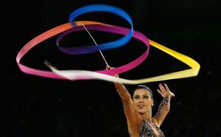 Rhythmic Gymnastics - Gold Coast 2018 Commonwealth Games - Team Final and Individual Qualification - Coomera Indoor Sports Centre - Gold Coast, Australia - April 11, 2018. Diamanto Evripidou of Cyprus competes using the ribbon. REUTERS/Jeremy Lee