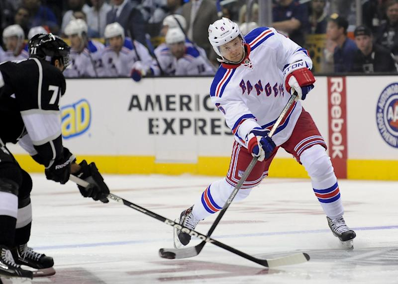 New York Rangers defenseman Anton Stralman (6), of Sweden, shoots past Los Angeles Kings center Jordan Nolan (71) during the first period of an NHL hockey game, Monday, Oct. 7, 2013, in Los Angeles. (AP Photo/Gus Ruelas)