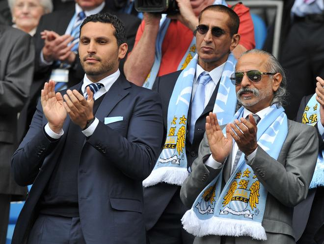 "Manchester City's chairman Khaldoon Al Mubarak (L) applauds before the English Premier League football match between Manchester City and Queens Park Rangers at The Etihad stadium in Manchester, north-west England on May 13, 2012. AFP PHOTO/PAUL ELLIS  RESTRICTED TO EDITORIAL USE. No use with unauthorized audio, video, data, fixture lists, club/league logos or ""live"" services. Online in-match use limited to 45 images, no video emulation. No use in betting, games or single club/league/player publications.PAUL ELLIS/AFP/GettyImages"