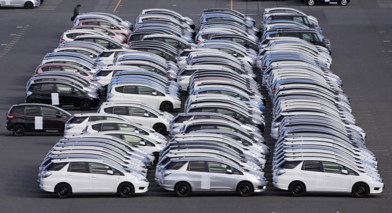 In this Dec. 20, 2012 photo, cars for export park at Yokohama port, south of Tokyo. Japan recorded a trade deficit of 777.5 billion yen ($8.1 billion) in February, despite the yen's weakening against the U.S. dollar, as exports of cars and auto parts slipped while imports surged nearly 12 percent.  It was the eighth consecutive monthly deficit, following a record monthly deficit of 1.63 trillion yen in January.(AP Photo/Koji Sasahara)