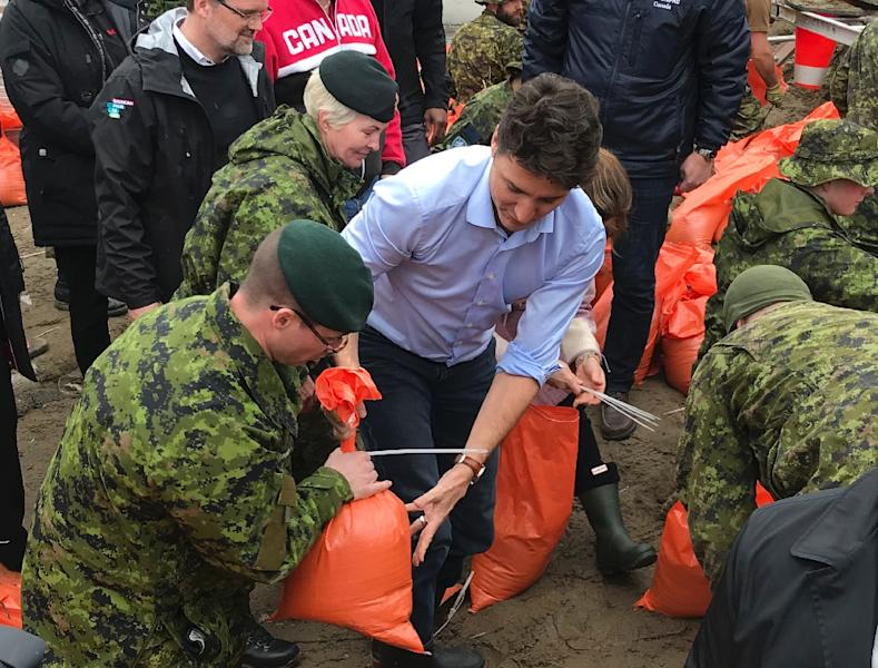 Soldiers have been helping fill sandbags and even Prime Minister Justin Trudeau and his wife Sophie dropped by to assist (AFP Photo/Michel COMTE)