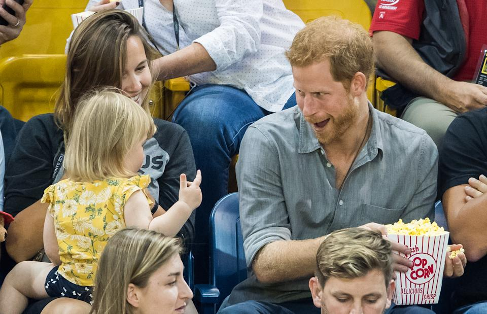 TORONTO, ON - SEPTEMBER 27:  Prince Harry (R) sits with David Henson's wife Hayley Henson (L) and daugther Emily Henson at the Sitting Volleyball Finals on day 5 of the Invictus Games Toronto 2017 on September 27, 2017 in Toronto, Canada.  The Games use the power of sport to inspire recovery, support rehabilitation and generate a wider understanding and respect for the Armed Forces.  (Photo by Samir Hussein/WireImage)