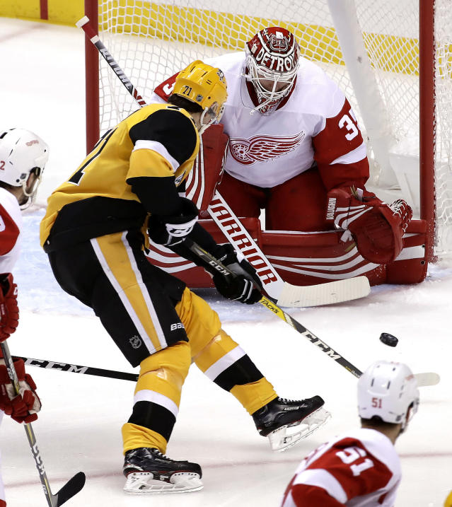 Pittsburgh Penguins' Evgeni Malkin (71) can't get off a shot in front of Detroit Red Wings goaltender Jimmy Howard (35) during the first period of an NHL hockey game in Pittsburgh, Thursday, Dec. 27, 2018. (AP Photo/Gene J. Puskar)