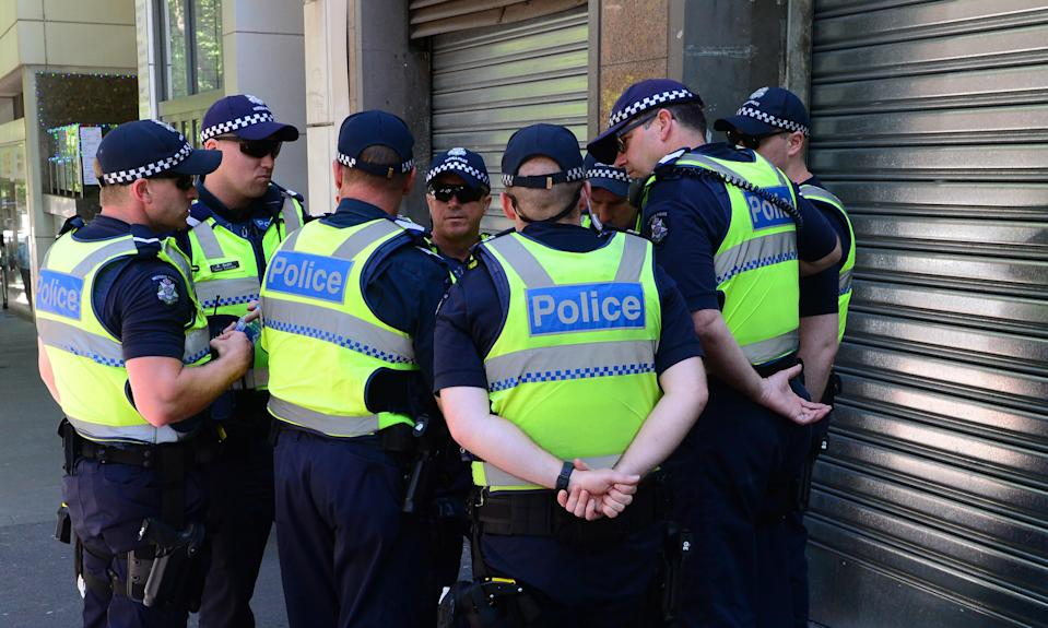 Police officers in Melbourne, Friday, Dec. 23, 2016. (AAP Image/Mal Fairclough)
