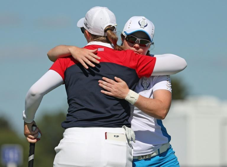 Europe's Leona Maguire hugs Jennifer Kupcho after her 5&4 victory over the American in the singles matches at the Solheim Cup (AFP/Maddie Meyer)