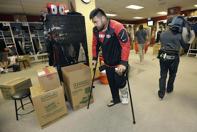 San Francisco 49ers guard Mike Iupati walks on crutches in the locker room at an NFL training facility in Santa Clara, Calif., Monday, Jan. 20, 2014. The 49ers lost to the Seattle Seahawks in the NFC Championship Game. (AP Photo/Jeff Chiu)