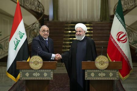Iranian President Hassan Rouhani shake hands with Iraq's Prime Minister Adel Abdul Mahdi during a news conference in Tehran, Iran, April 6, 2019. Official Iranian President website/Handout via REUTERS